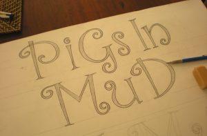 Pigs in Mud sign